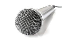 Micrófono en el fondo blanco Imagenes de archivo