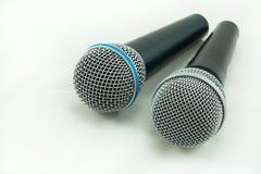 Micrófono en el fondo blanco Imagen de archivo