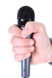 Micrófono en la mano del hombre Imágenes de archivo libres de regalías