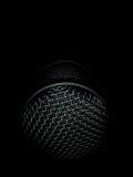 Micrófono en la oscuridad Foto de archivo libre de regalías
