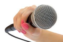 Micrófono en una mano Imágenes de archivo libres de regalías