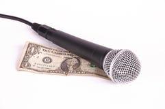 Micrófono y dólar Foto de archivo libre de regalías