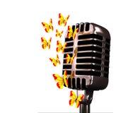 Micrófono y mariposas Imagen de archivo libre de regalías