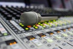 Micrófono y mezclador de la música Fotografía de archivo libre de regalías