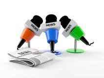 Micrófonos con el periódico Fotografía de archivo