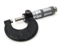Micrómetro contra un fondo blanco Imagen de archivo