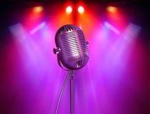 Micrófono retro con los reflectores Foto de archivo libre de regalías
