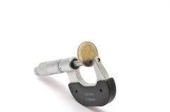 Micrómetro y moneda Fotos de archivo libres de regalías