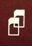 Micro карточки SIM на коричневом цвете Стоковое Изображение RF