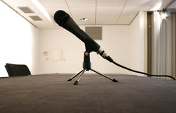 Micro. Black microphone waiting for a meeting on a white room Stock Photo