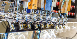 Micro Brew or Draft Beer Taps. Row of draft beer taps at a bar in Montgomery Alabama Royalty Free Stock Photo