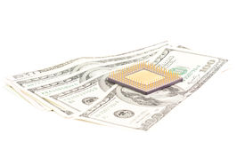 Micro chip with dollar bills Stock Images