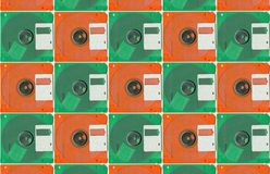 Micro floppy disc orange green Stock Image
