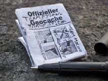Micro Geocache logbook. Micro geocaching logbook to record your find Royalty Free Stock Images
