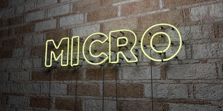 MICRO - Glowing Neon Sign on stonework wall - 3D rendered royalty free stock illustration Royalty Free Stock Photo