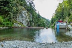 Micro hydro electric dam in Carpathian Mountains Stock Photo