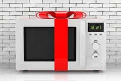 Micro-ondas Oven Gift com fita e curva vermelhas rendição 3d Fotos de Stock