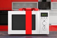 Micro-ondas Oven Gift com fita e curva vermelhas rendição 3d Imagem de Stock Royalty Free