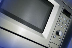 Micro-onde avec la lumière bleue images libres de droits