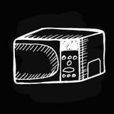 Micro-onde sur le tableau noir Images libres de droits