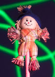 Micro Scarecrow. A little scarecrow made with textile and straw, with in the background a laser-made green line Royalty Free Stock Image