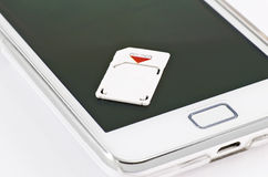 Micro sim. On a smartphone Stock Images