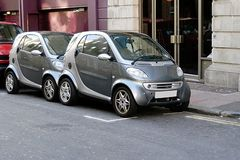 Micro smart cars share space. Two identical Smart Cars share a single parking space on a European street Stock Photography