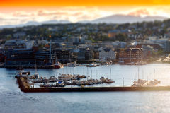 Micro toy Tromso city port background Stock Image