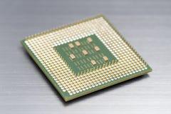 Micro unità di elaborazione sul pavimento d'argento fotografia stock