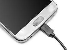 Micro usb cable. Close up USB cable on smartphone Stock Photography