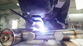 Micro welding. Operator use electro spark engraving equipment for carbide metal at factory. Static shot