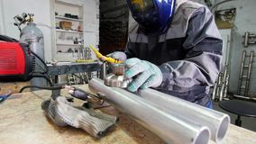 Micro welding. Working man in mask use electro spark engraving equipment for carbide metal at factory.