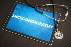 Microangiopathy (heart disorder) diagnosis medical concept on ta. Blet screen with stethoscope stock images