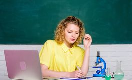 Microbiology concept. Student girl with laptop and microscope. Molecular biology PhD projects. Scientist microbiology. Study microbiology. Investigate stock image
