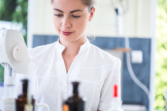 Microbiology student during internship. Image of female microbiology student during internship in professional lab stock image