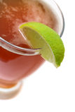 Microbrew beer and lime slice Royalty Free Stock Photos