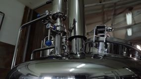 Microbrewery equipment. Close up tanks in brewery warehouse. Metal brewery vessels. Small business concept. Microbrewery equipment. Close up tanks in brewery stock footage
