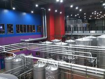 Microbrewery. Pipes and large vats in a microbrewery are shown Royalty Free Stock Image