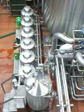 Microbrewery. Pipes and vats in a microbrewery are shown Royalty Free Stock Photos