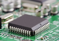Microchip. Electronic chip on circuit board stock photography