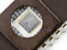 Microchip. EPROM memory microchip with a transparent window, showing the integrated circuit inside Stock Photos