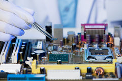 Microchip assembling Royalty Free Stock Photo