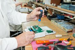 Microchip assembling manufacture. Technology process of microchip device assembling at manufacture Stock Photos