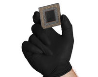 Microchip and black gloves. On white Stock Photos