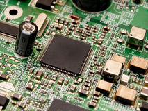 A Microchip on a circuit board royalty free stock image