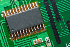 Microchip on circuit board. Royalty Free Stock Images