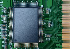 Microchip on a circuit board Royalty Free Stock Photography