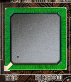 Microchip on a circuit board Royalty Free Stock Image