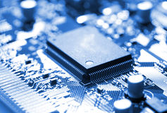 Microchip on circuit board. Close-up microchip on circuit board, blue toning Royalty Free Stock Photos