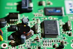 Microchip. Closeup of a board with microchips and transistors Stock Photo